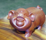 Statue of smiling pig Stock Photo