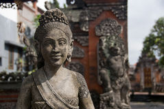 Statue of a smiling women. Photo of this statue was taken on Bali Royalty Free Stock Images