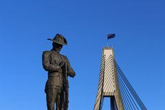 Statue of a soldier with the Anzac bridge. Anzac Day. Remembrance Day. Anzac Day. Four metre bronze statue of an Australian World War One Digger and the Anzac stock photography
