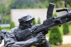 Statue of soldier fight machine gun Royalty Free Stock Image