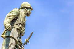 Statue of a soldier of First World War. Leaning forward holding a bayonet rifle stock photo