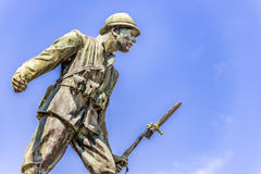 Statue of a soldier of First World War. Leaning forward holding a bayonet rifle stock photos