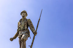 Statue of a soldier of First World War. Leaning forward holding a bayonet rifle royalty free stock photography