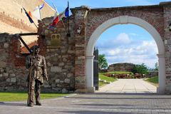 Statue of a soldier standing in front of a city gate in Alba Iulia Stock Image