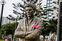 Statue with some flowers. In the hands Royalty Free Stock Photos