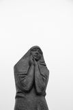 Statue of a sorrowful women with hands near face. Statue of a sorrowful women with hands on face on white background royalty free stock photography