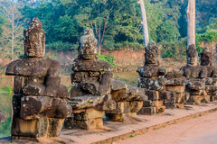 Statue south gate bridge angkor thom cambodia Royalty Free Stock Photo