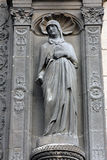 Statue at the south portal of the church of St. Eustache, Paris Stock Photography