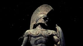 Statue of spartan warrior with dust floating around. Dramatic spartan statue on black with dust floating around stock footage