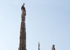 Statue on a spire Stock Photos