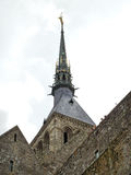 Statue on spire of tower abbey mont saint-michel Royalty Free Stock Photos