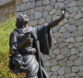 Statue of St Benedict as a boy. This statue in Subiaco depicts St Benedict as a boy staring at the mountains. Photo taken April 2015 Royalty Free Stock Images
