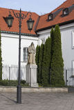 Statue of St Benedykt outside Saint Kazimierz Church in New Town of Warsaw in Poland Stock Photo