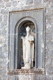 Statue of St Blaise on the wall of old town Dubrovnik Stock Image