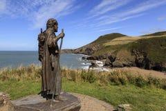 The statue of St Crannog. Overlooking Llangannog beach Royalty Free Stock Photos