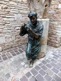 Statue of St. Francis in the garden of the monastery in Assisi, Stock Photography