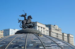 Statue of St. George on the dome of the underground shopping center Okhotny Ryad Stock Image