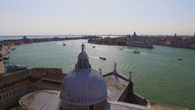 Statue of St. George standing on dome of cathedral, view of Grand Canal, Venice. Stock footage stock footage