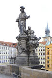 Statue of St. Ivo. Charles Bridge in Prague. Stock Photos