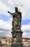 Statue of St. John the Baptist. Charles Bridge in Prague. Royalty Free Stock Images