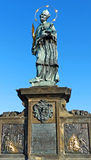 Statue of St. John of Nepomuk on Charles Bridge in Stock Photos