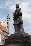 Statue with St. Jost Church Royalty Free Stock Photos