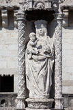 Statue of St. Mary and Child at Belem tower in Portugal Stock Photos