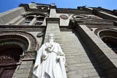 The statue of St. Paul in front of the church Royalty Free Stock Image