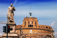 Statue of St. Paul on Ponte Sant Angelo the Bridge of Angels with Castel Sant Angelo in the background Royalty Free Stock Photos