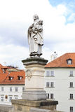 Statue of St. Philip Benitius. Charles Bridge in Prague. Royalty Free Stock Photography