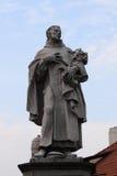Statue of St. Philip Benitius on the Charles Bridge in Prague Royalty Free Stock Photo