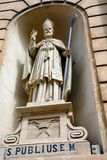 Statue of St Publius, Bugibba. Statue of St Publius in an alcove on the front of the Parish church of our lady of sorrows, Bugibba, Malta, Europe Stock Photo