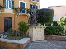 Statue of St. Rocco in Fondi, Italy. Fondi, Italy - 10 june 2013: Statue of St. Rocco. Fondi`s urban core is located in the south pontino halfway between Rome Stock Photo
