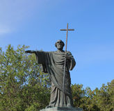 Statue St. seer in the hands of cross. Monument holy men who carries a cross Royalty Free Stock Photography