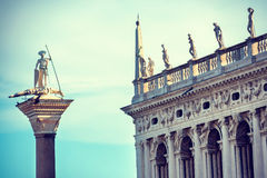 The statue of St. Theodore and Doge's Palace in Venice Stock Photography