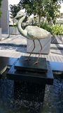 Statue. Steel bird statue on water feature stock photos