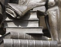 Statue stone books royalty free stock photo