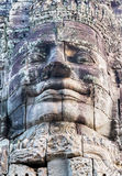 Statue Stone smiling face in Prasat Bayon, part of Angkor. Statue stone faces of king Bayon Temple Angkor Thom, Cambodia. Ancient monument Khmer architecture Royalty Free Stock Photo