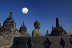Statue and stupa at borobudur Stock Images