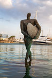 The statue of a surfer in the bay of Alicante, Spain. Royalty Free Stock Photo