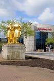 Statue and Symphony Hall, Birmingham. Statue of Matthew Boulton, James Watt, and William Murdoch by William Bloye with the Symphony Hall to the rear, Broad Stock Images
