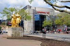 Statue and Symphony Hall, Birmingham. Statue of Matthew Boulton, James Watt, and William Murdoch by William Bloye with the Symphony Hall to the rear, Broad Royalty Free Stock Photos