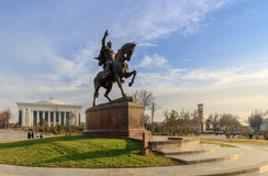 Statue of Tamerlane and Palace of Forums in center of Tashkent at sunset, Uzbekistan Stock Photo