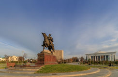 Statue of Tamerlane and Palace of Forums in center of Tashkent at winter time, Uzbekistan Royalty Free Stock Photos
