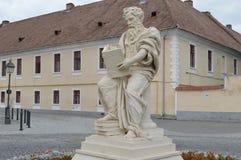 Statue teacher who reads Stock Photos