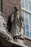 Statue of 18th century woman on Meisjeshuis Delft Stock Photos
