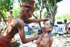 """Statue at Thailand Hell Horror Park. Ones who violate the fourth of the Five Precepts """"Telling a lie, Deceiving the others' Properties"""" receive the results Royalty Free Stock Photo"""