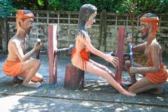 """Statue at Thailand Hell Horror Park. Ones who violate the second of the Five Precepts """"Stealing, Cheating or destroying the others' Properties"""" receive the Royalty Free Stock Image"""
