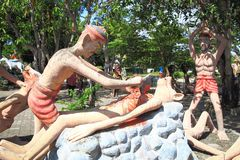 """Statue at Thailand Hell Horror Park. Ones who violate the third of the Five Precepts """"Killing or destroying the others and animals receive the results of the Stock Photo"""