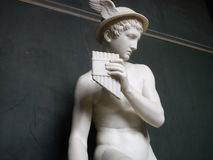Statue by thorvaldsen. Boy statue in marble with pan flute Stock Image